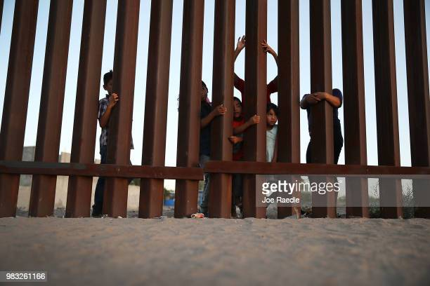 Children gather together on the Mexican side of the US/Mexico border fence on June 24 2018 in Sunland Park New Mexico The Trump administration's...
