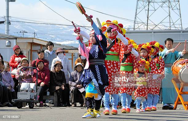 Children gathered from different evacuated locations perform 'Taue Odori' or Rice Planting Dance as a part of the 'Anba Festival' traditional...