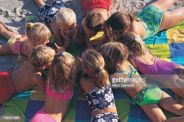 Children gathering on the sand