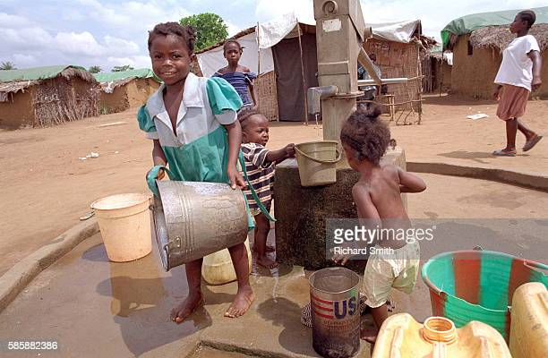 Children Gathering Water at Displacement Camp