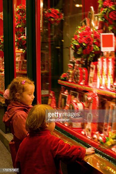 Children gazing at a candy shop window