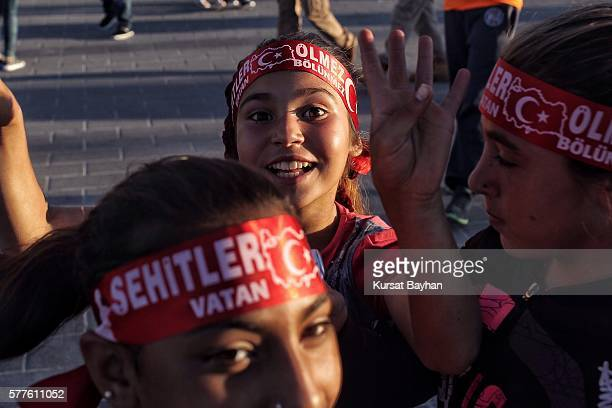 Children gesture as they gather at Istanbul's central Taksim Square on July 19 2016 in Istanbul Turkey Clean up operations are continuing in the...