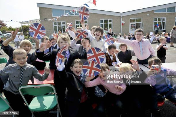 Children get into the spirit at the Bucklebury Church of England Primary School Royal wedding party in the school playground