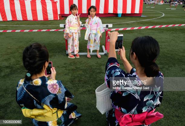 Children get their photo taken near the main stage during the 42th Bon Odori festival on July 21 2018 in Shah Alam Malaysia More than 30000 attendees...