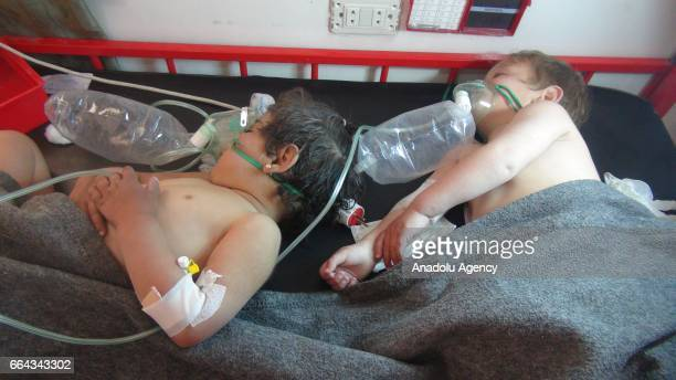 Children get treatment at a hospital after a suspected chlorine gas attack by Assad Regime forces to Khan Shaykhun town of Idlib Syria on April 4 2017