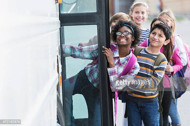 children getting on school bus - open backpack stock pictures, royalty-free photos & images