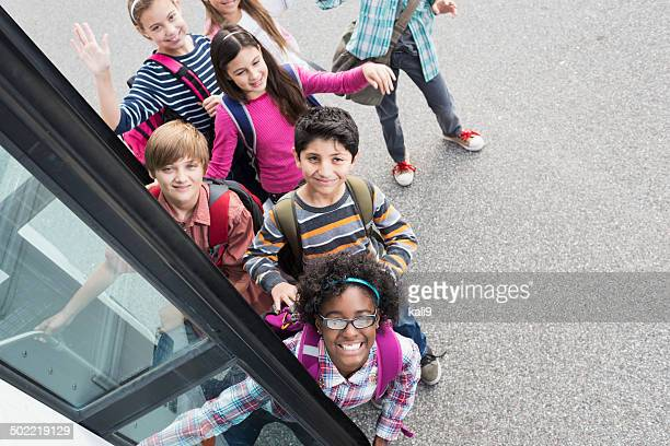 Children getting on school bus