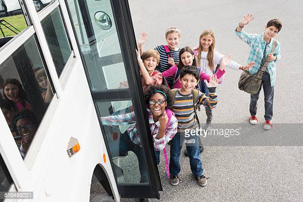 children getting on school bus - field trip stock pictures, royalty-free photos & images