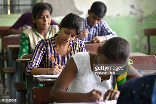 Children getting ready for the first paper of Secondary School Certificate exam at Shivaji Sikshan Santha Multi Purpose Technical High School at...