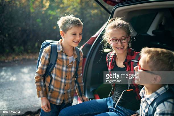 children getting ready to autumn forest hike - open backpack stock pictures, royalty-free photos & images