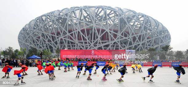 """Children give a display of their roller-skating skills in front of the National Stadium, also known as the """"Bird's Nest"""" for its design, ahead of a..."""