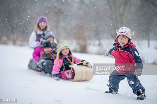 Children Going Sledding Together