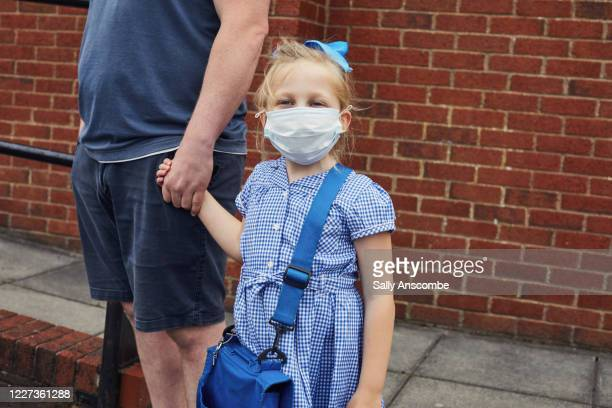 children going to school wearing face masks - school building stock pictures, royalty-free photos & images