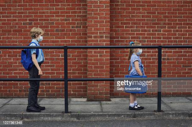 children going to school wearing face masks - uk stock pictures, royalty-free photos & images