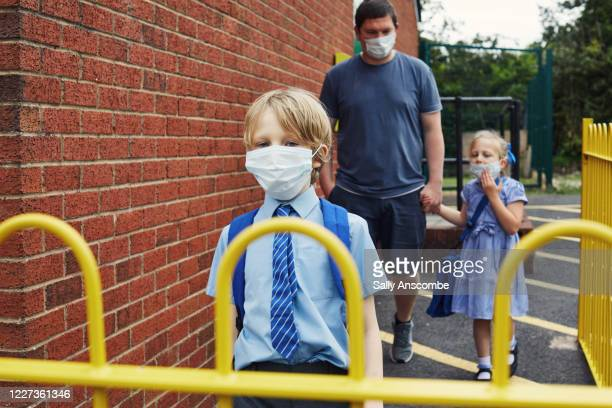 children going to school wearing face masks - cold and flu stock pictures, royalty-free photos & images
