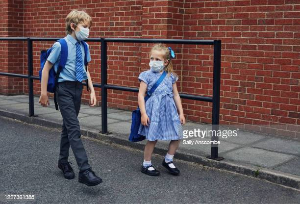 children going to school wearing face masks - uniform stock pictures, royalty-free photos & images