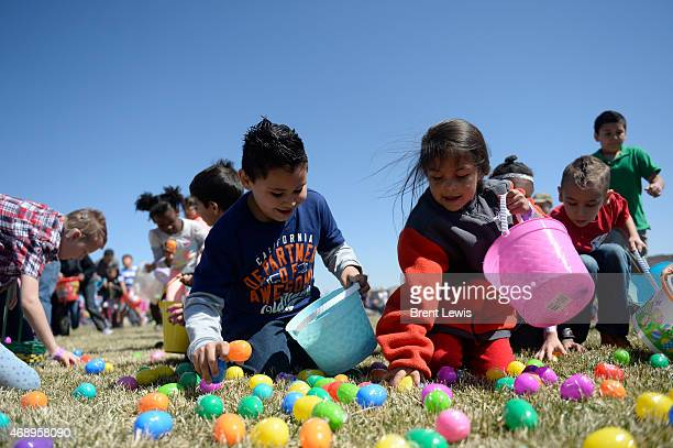 Children grab eggs off the ground during an Easter egg hunt Friday April 32015 at The Potter's House of Denver in Denver Colorado The church released...