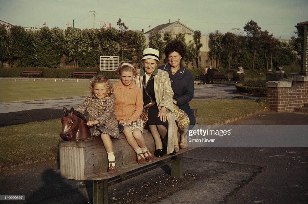 Children, grandmother & mother in playground : Stock Photo