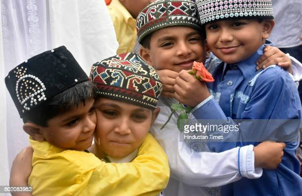 Children greet each other after offering Eid alFitr prayers at outside Bandra station on June 26 2017 in Mumbai India Eid alFitr marks the end of the...