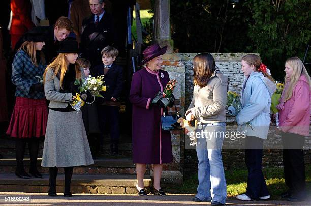 Children hand flowers and gifts to Britain's Queen Elizabeth II as she leaves St Mary Magdalene's church on the Sandringham estate after attending...