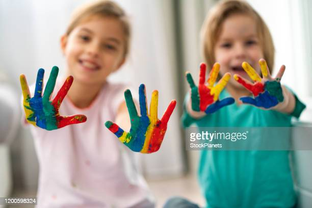 children hands - 4 girls finger painting stock pictures, royalty-free photos & images