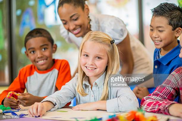 Children Happily Creating Art Projects