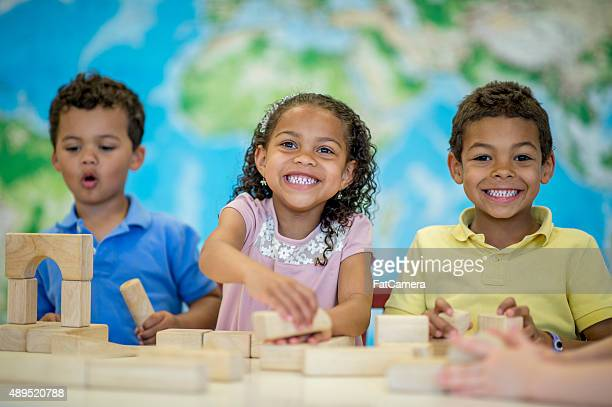 Children Happily Playing with Blocks