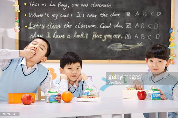 Children have lunch in classroom