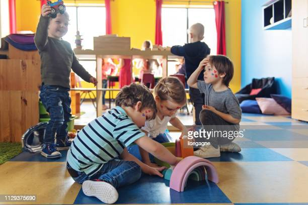 children having crafting activity - nursery school building stock pictures, royalty-free photos & images