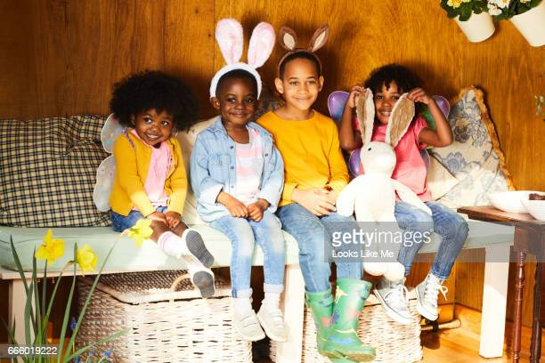 children having easter fun. - easter bunny costume stock pictures, royalty-free photos & images