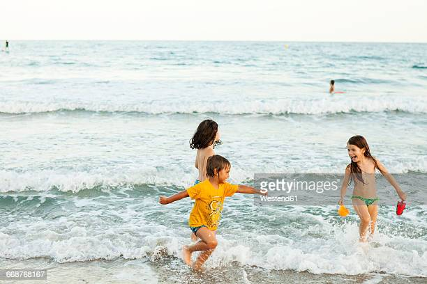 children having fun at seafront - wet t shirt girls stock photos and pictures