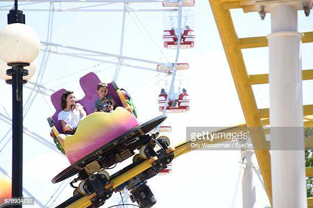 Children Having Fun In Amusement Park