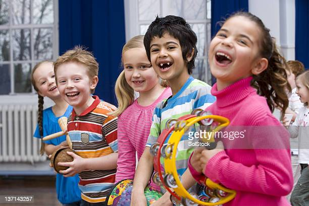 Children Having Fun in Music Class With Their Instruments