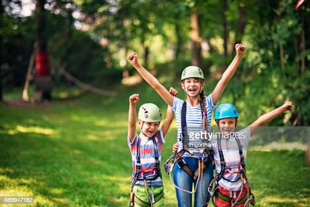 Children having fun in ropes course adventure park