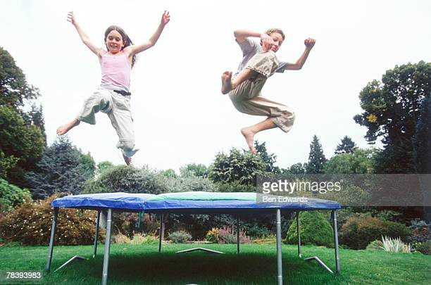 Children having fun on trampoline