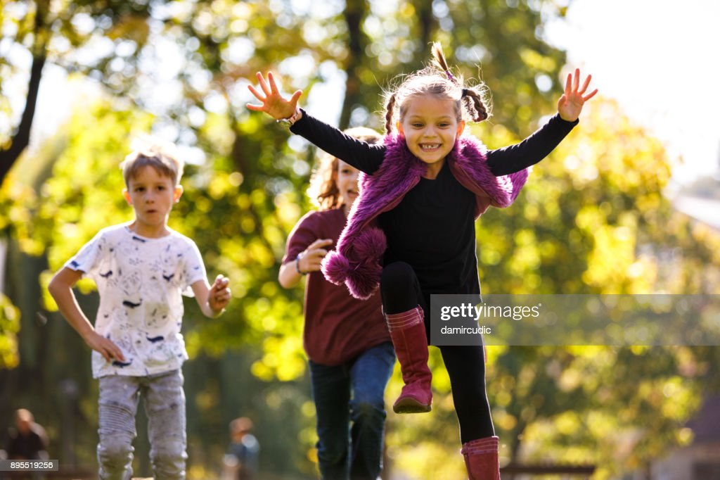 Children having fun outdoor : Stock Photo