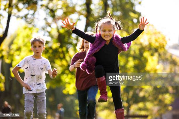 children having fun outdoor - skipping along stock photos and pictures