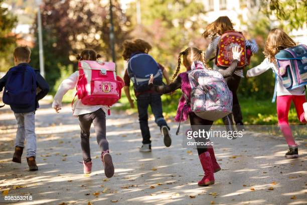 children having fun outdoors - education stock pictures, royalty-free photos & images