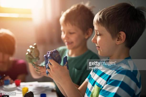 Children having fun painting easter eggs