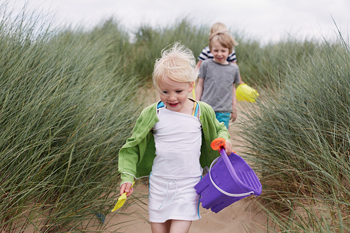 Children having fun playing on the beach - gettyimageskorea