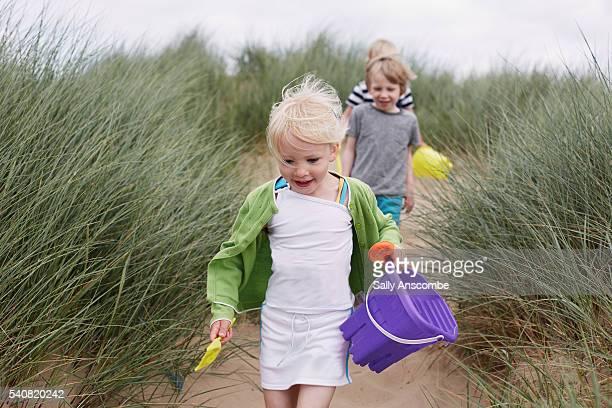 Children having fun playing on the beach