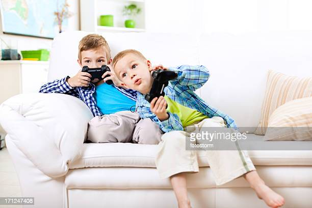 Children having fun, playing video games