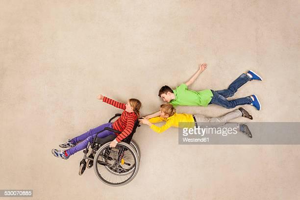 Children having fun with handicapped friend