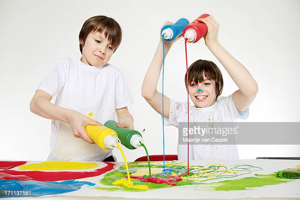 Children having fun with Paint