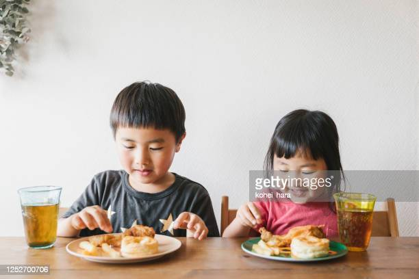 children having lunch at home - childhood stock pictures, royalty-free photos & images