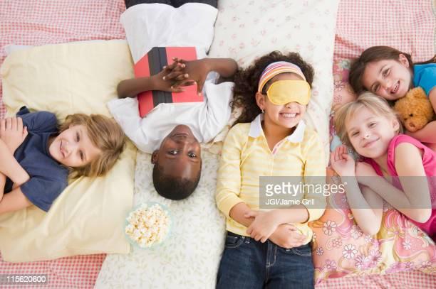Children having slumber party together