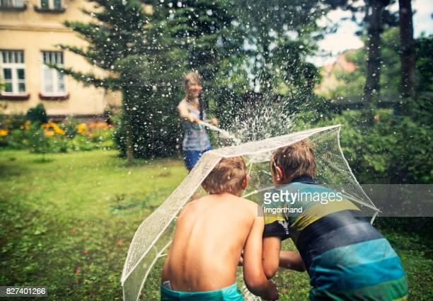 Children having splashing fun in back yard