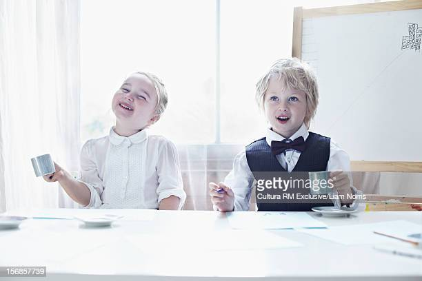 Children having tea party together