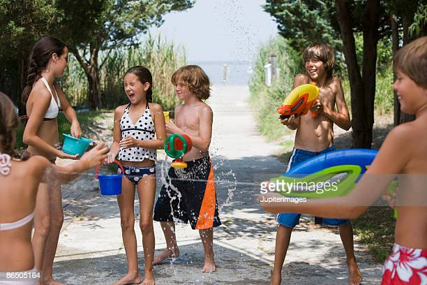 Children having water fight
