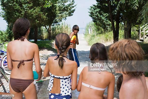 Children having water fight